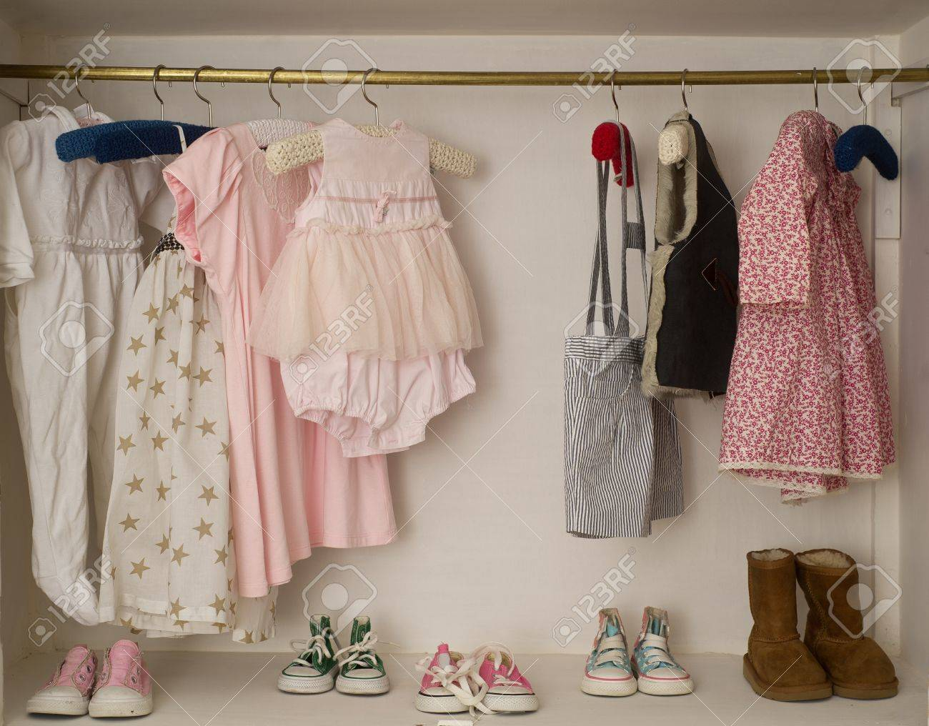 Baby Girl Cute Closet With Handing Dress Boots Stock Photo   16564404