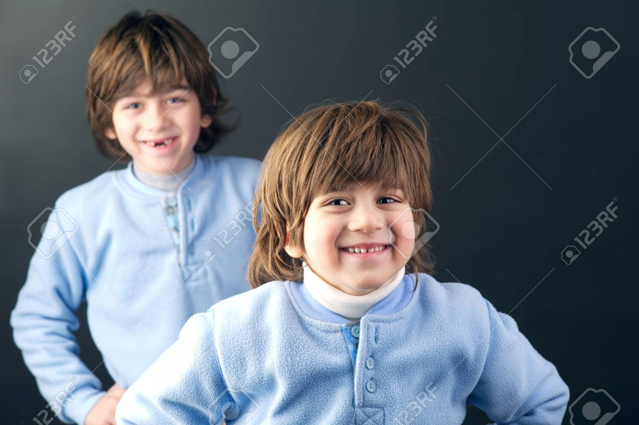 Studio portrait of two young brothers posing Stock Photo - 25067155