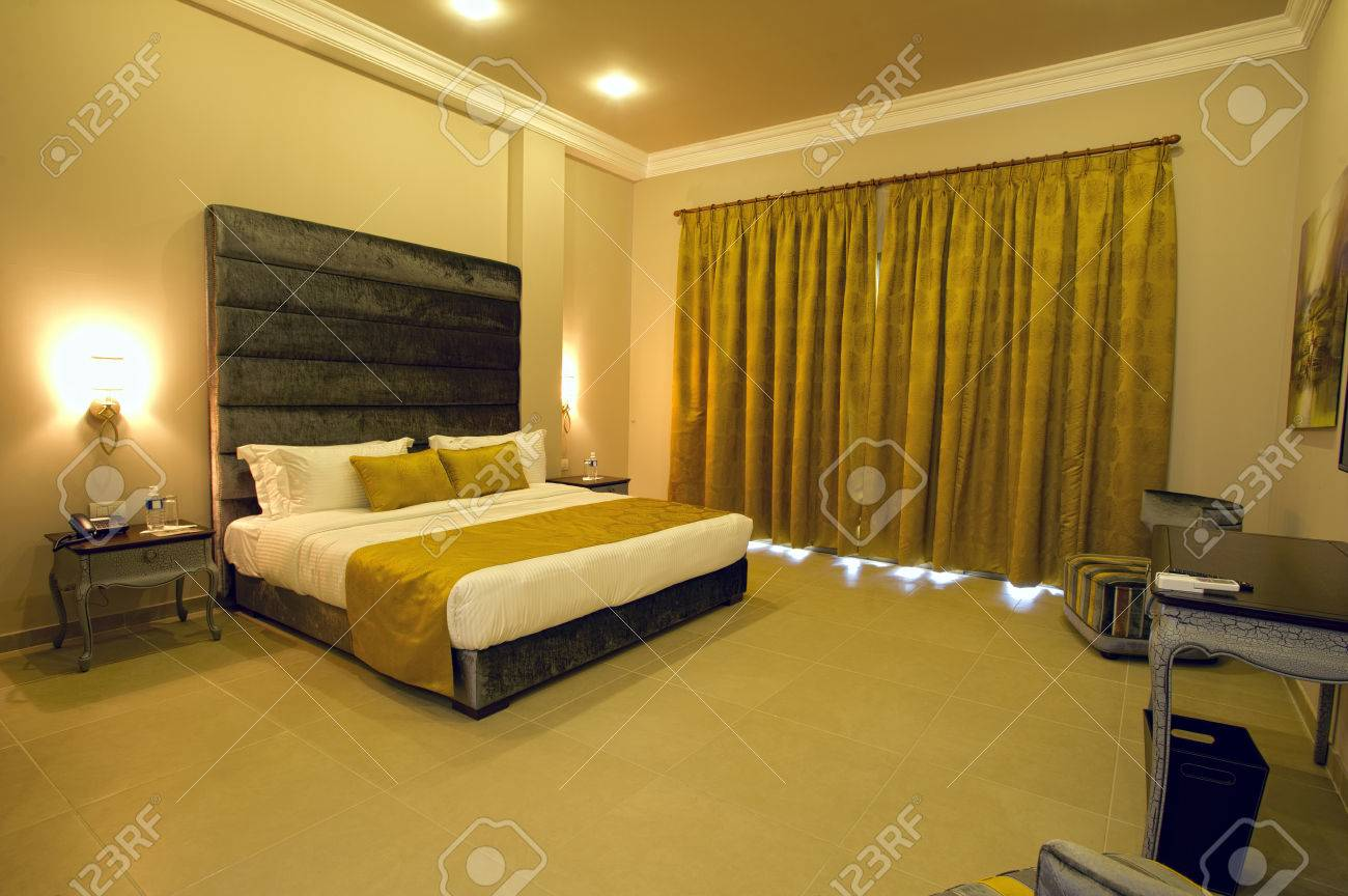 image photo stock photos hotel woman curtains opening