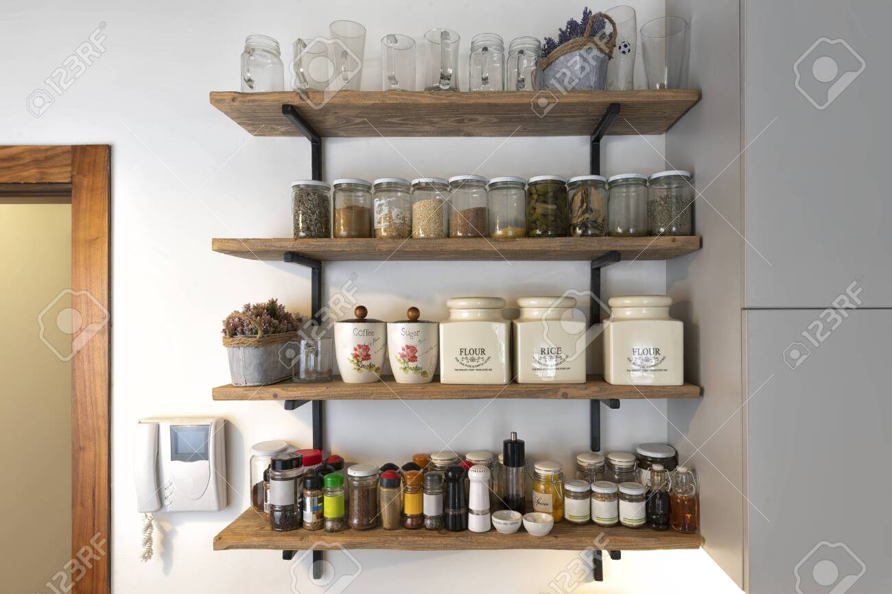 Kitchen Shelves With Various Food Ingredients And Spices ...