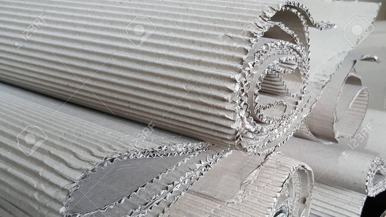 Roll of wave craft paper folded in random, brown Corrugated cardboard,