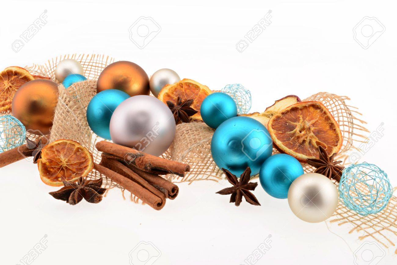 christmas decoration with blue and white christmas balls orange slices and cinnamon stock photo