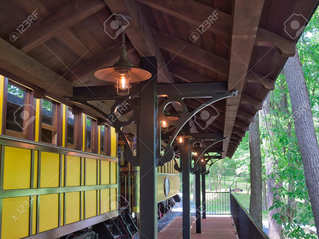 A Train Station Platform with an Antique Passenger Car - 162658704