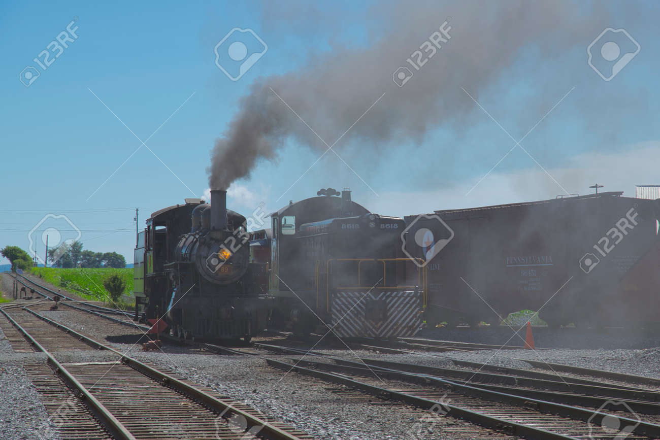 Strasburg, Pennsylvania, July 2018 - A 1906 Steam Locomotive and a Diesel Locomotive Seating Side by Side - 165167368