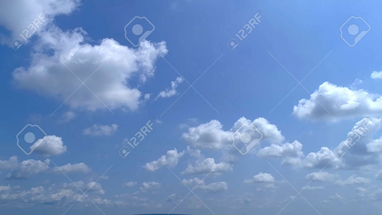 Blue Sky with White Fluffy Clouds as a Back Ground - 165159441