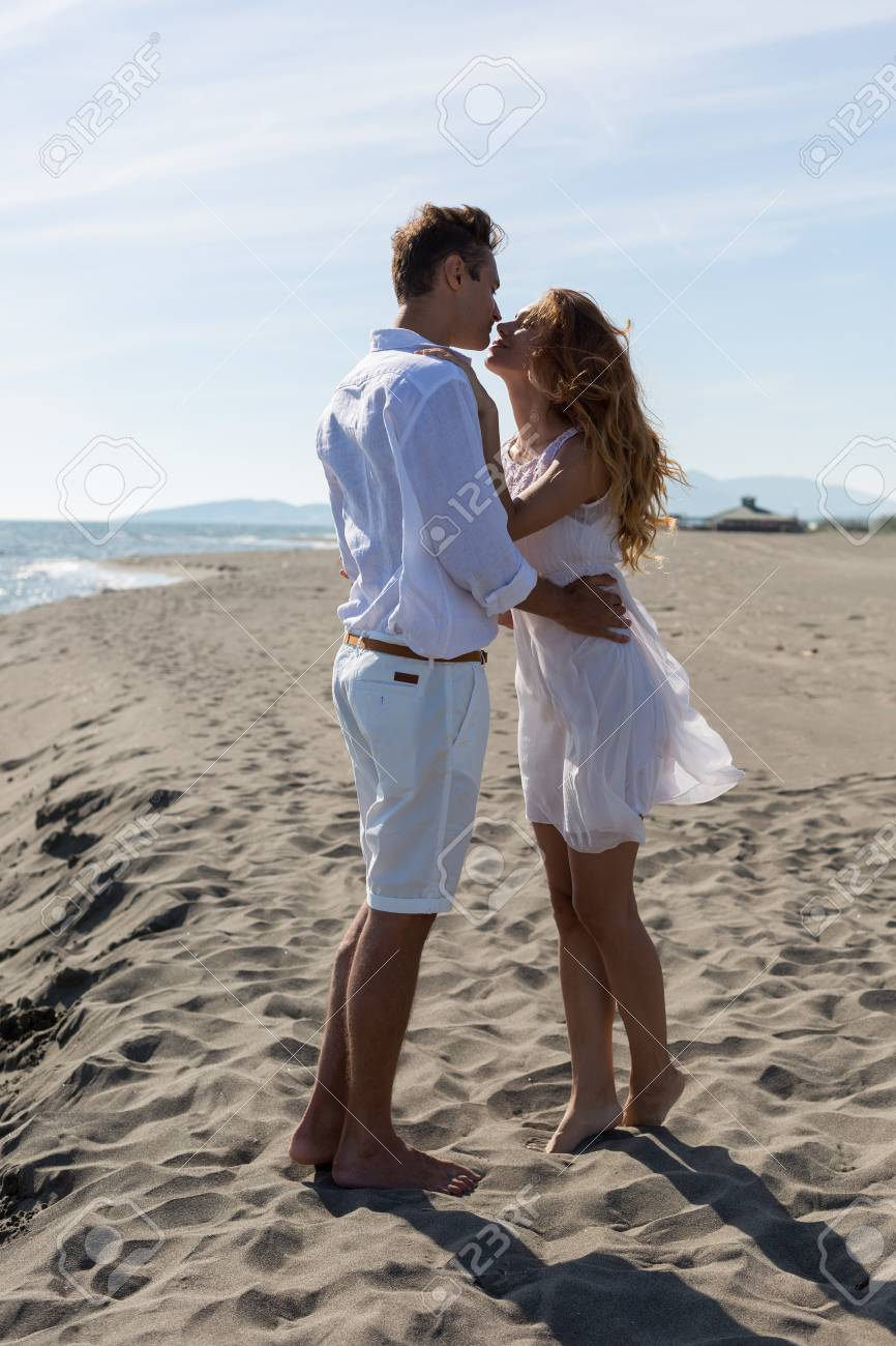 Happy Couple In Love Walking On The Beach In Summer White Dress Stock  Photo, Picture And Royalty Free Image. Image 44740663.