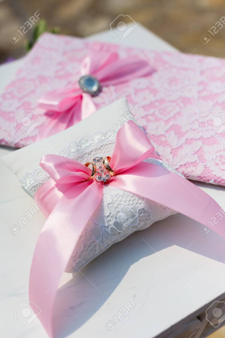 Pink Wedding Folder And Pillow With Rings Stock Photo, Picture And ...
