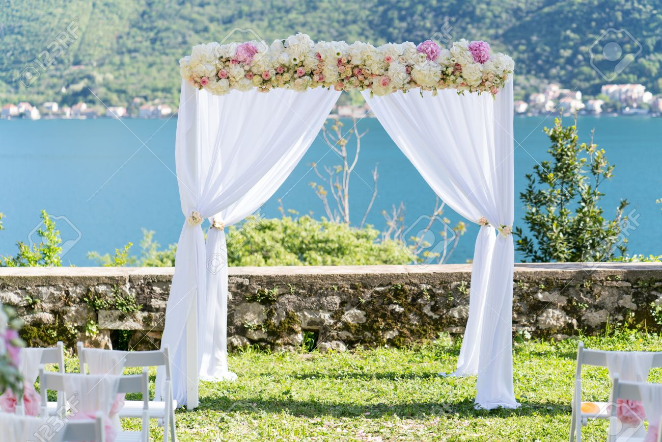 Arch For The Wedding Ceremony, Decorated With Cloth And Flowers ...
