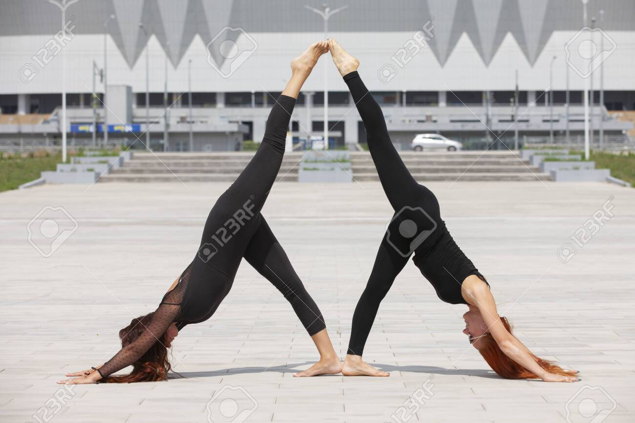 Two Young Caucasian Women Yogi Doing Balance Back Stretch Acro Stock Photo Picture And Royalty Free Image Image 127808383