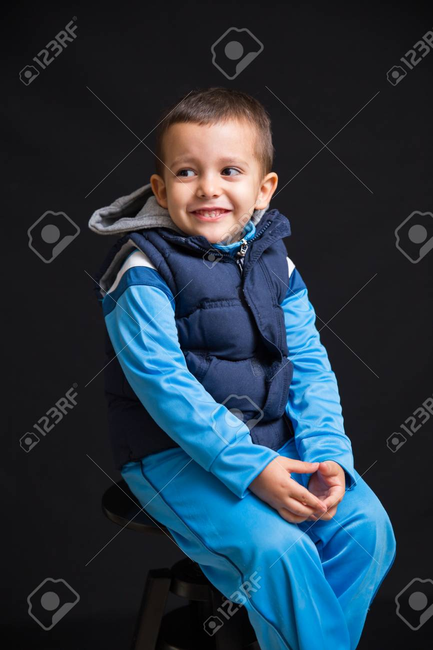 Magnificent Portrait Of Little Boy Smiling And Sitting On A Black Stool Creativecarmelina Interior Chair Design Creativecarmelinacom