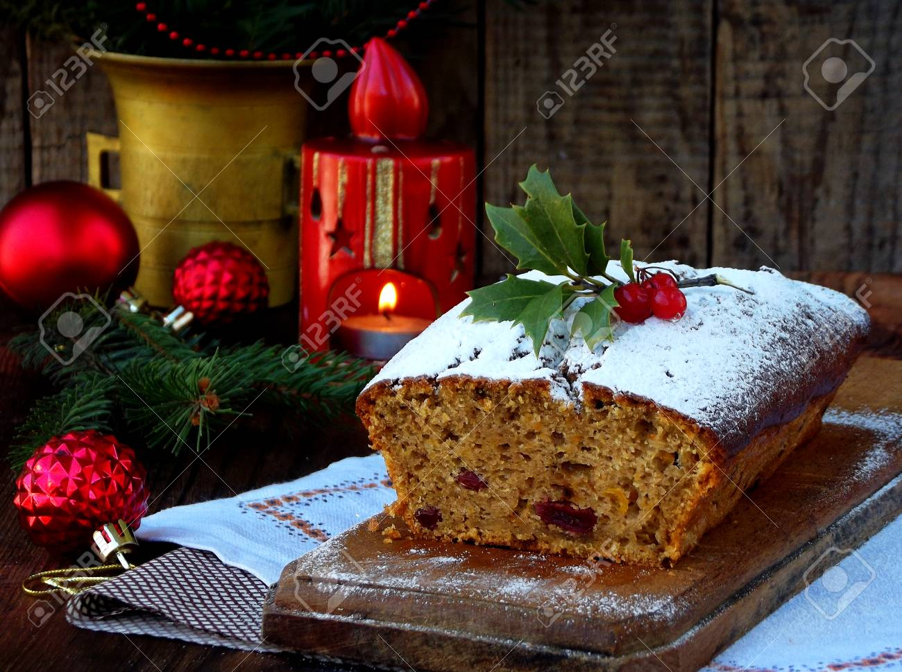 Christmas Cake Decorations.Traditional Christmas Fruit Cake Decorated With Powdered Sugar