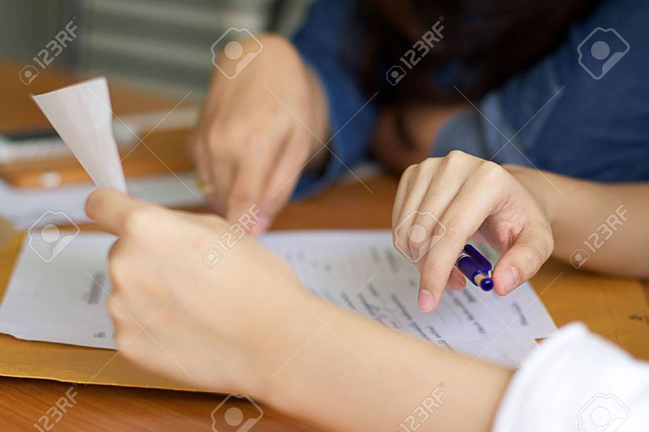 Bussines Women filling a Paperwork for agreement - 33905972