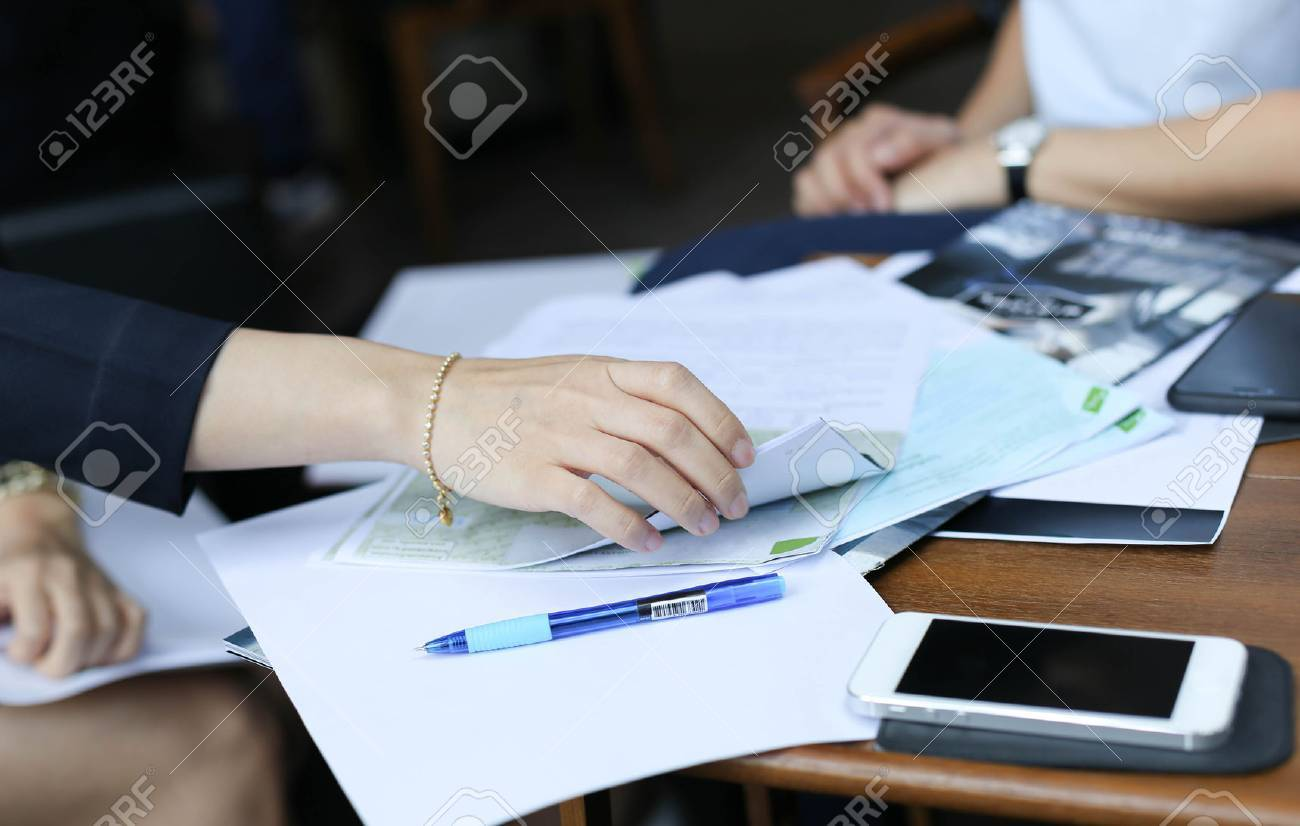 Businesswoman are prepare a contract documents agreement - 38974858