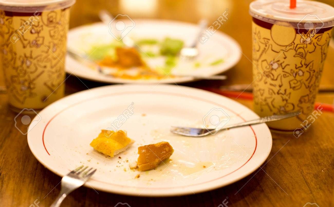 Small Bit Of Bread With Condensed Milk Left Over On The Plate Stock Photo,  Picture And Royalty Free Image. Image 50862619.