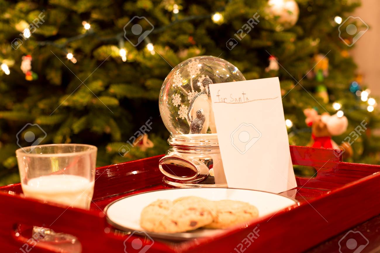 Letter For Santa With Cookies And Glass Of Milk From A Little