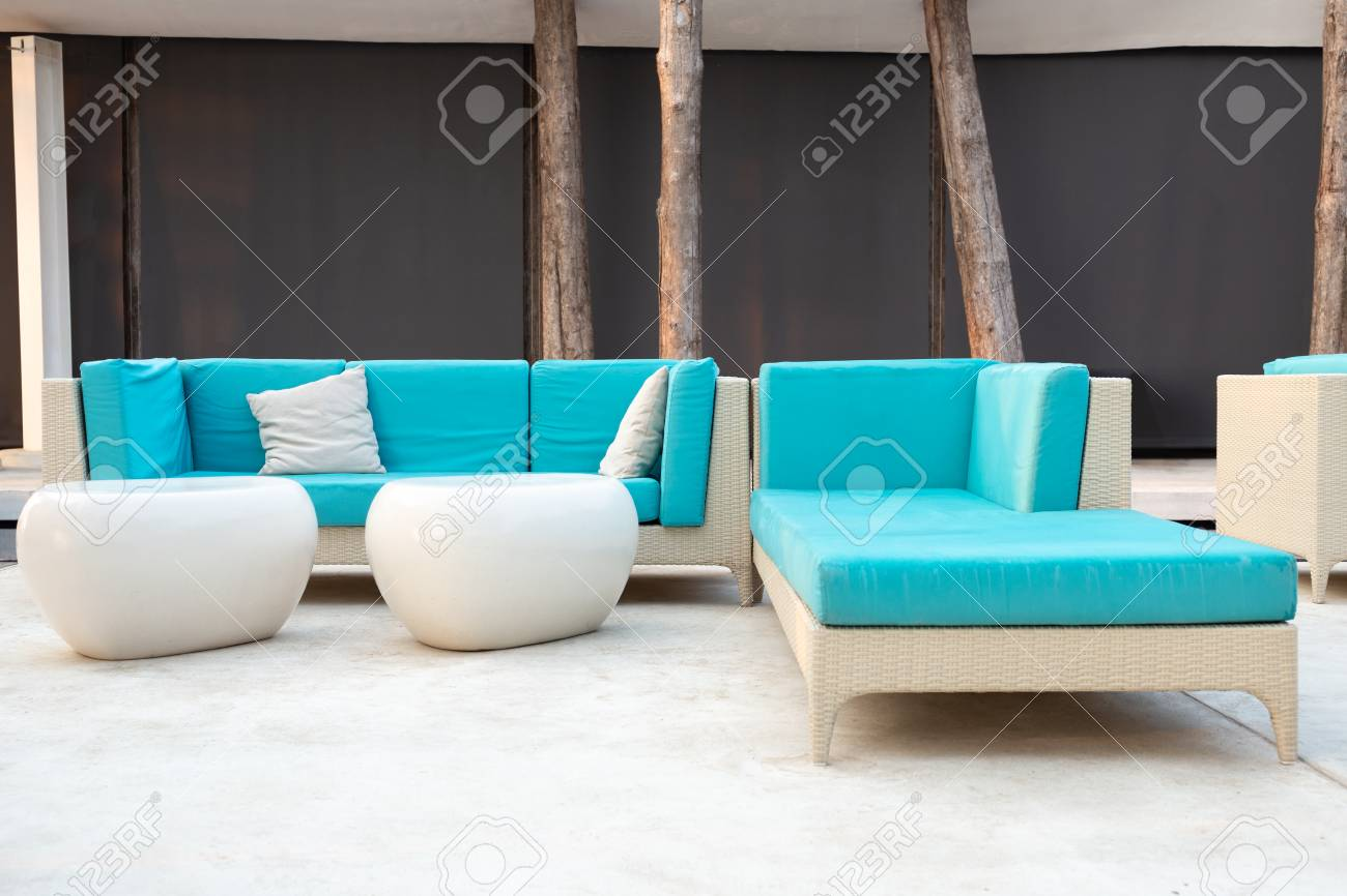 White Rattan Garden Furniture With Blue Cushion On Resort Terrace Stock Photo Picture And Royalty Free Image Image 119359024
