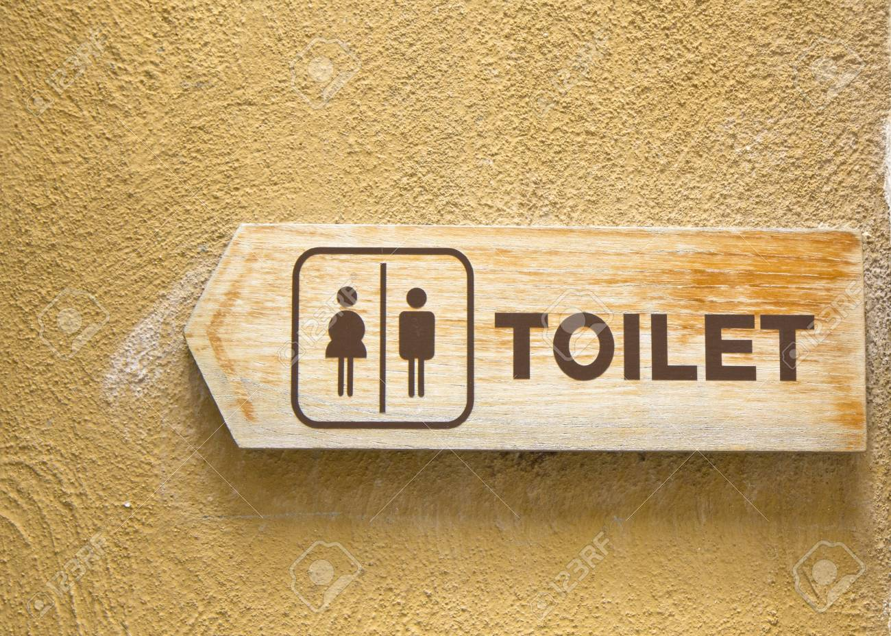 toilet plate sign on orange wall. Stock Photo - 21615792