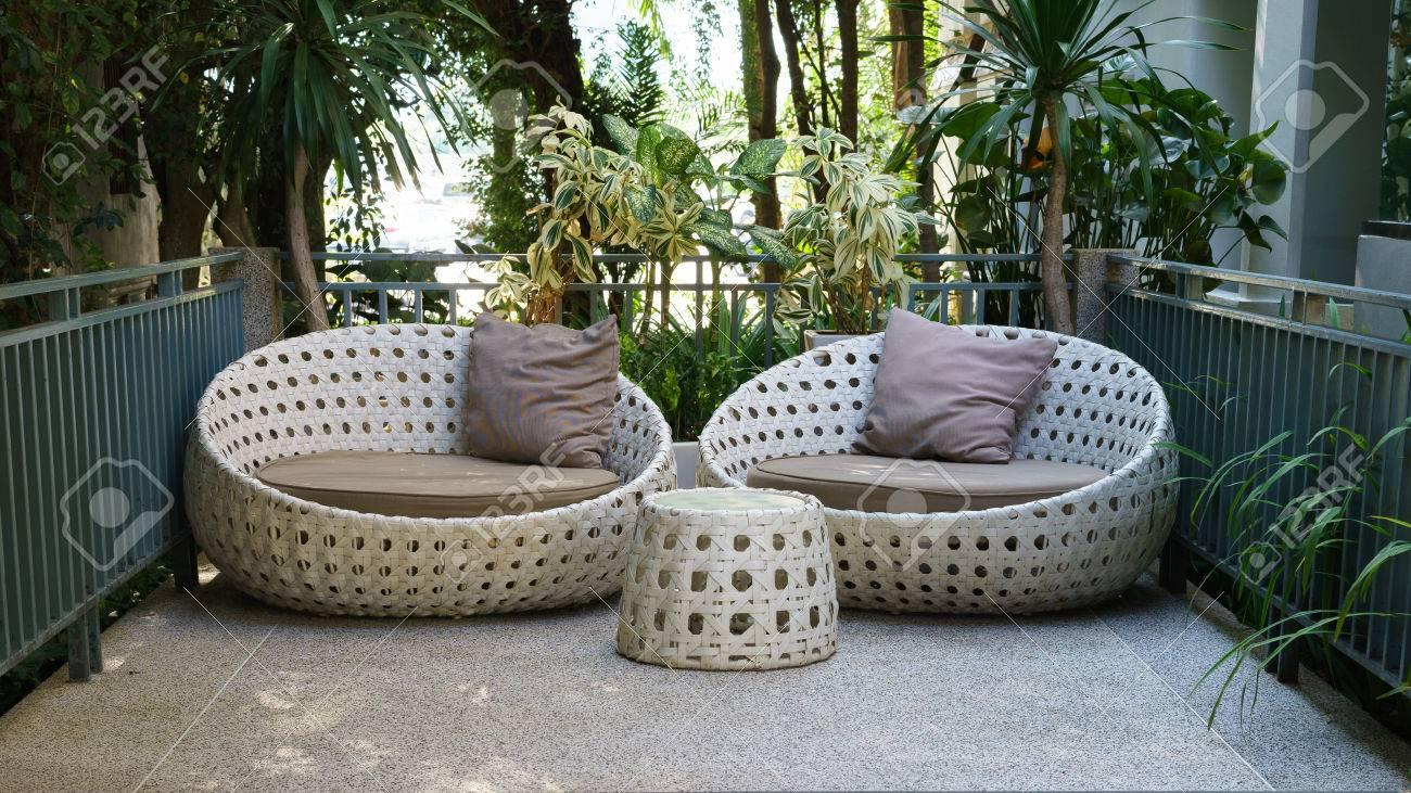 modern garden sofa or love seat in the home garden - 54780149