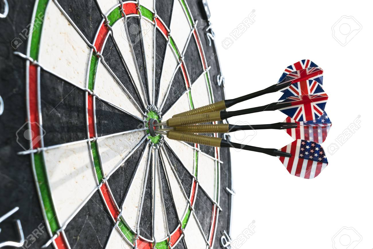 metal darts have hit the red bullseye on a dart board darts stock
