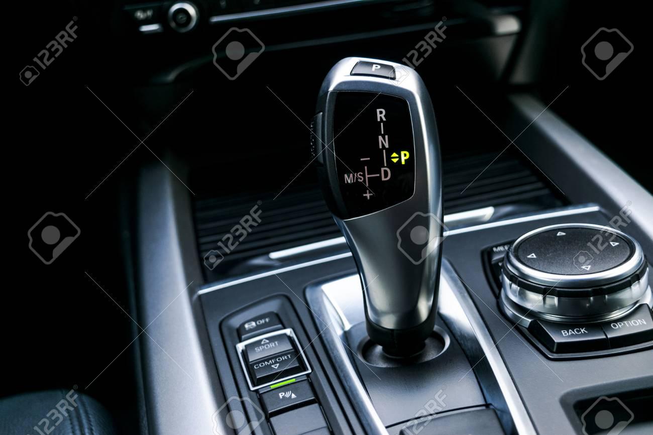 Automatic gear stick (transmission) of a modern car, multimedia