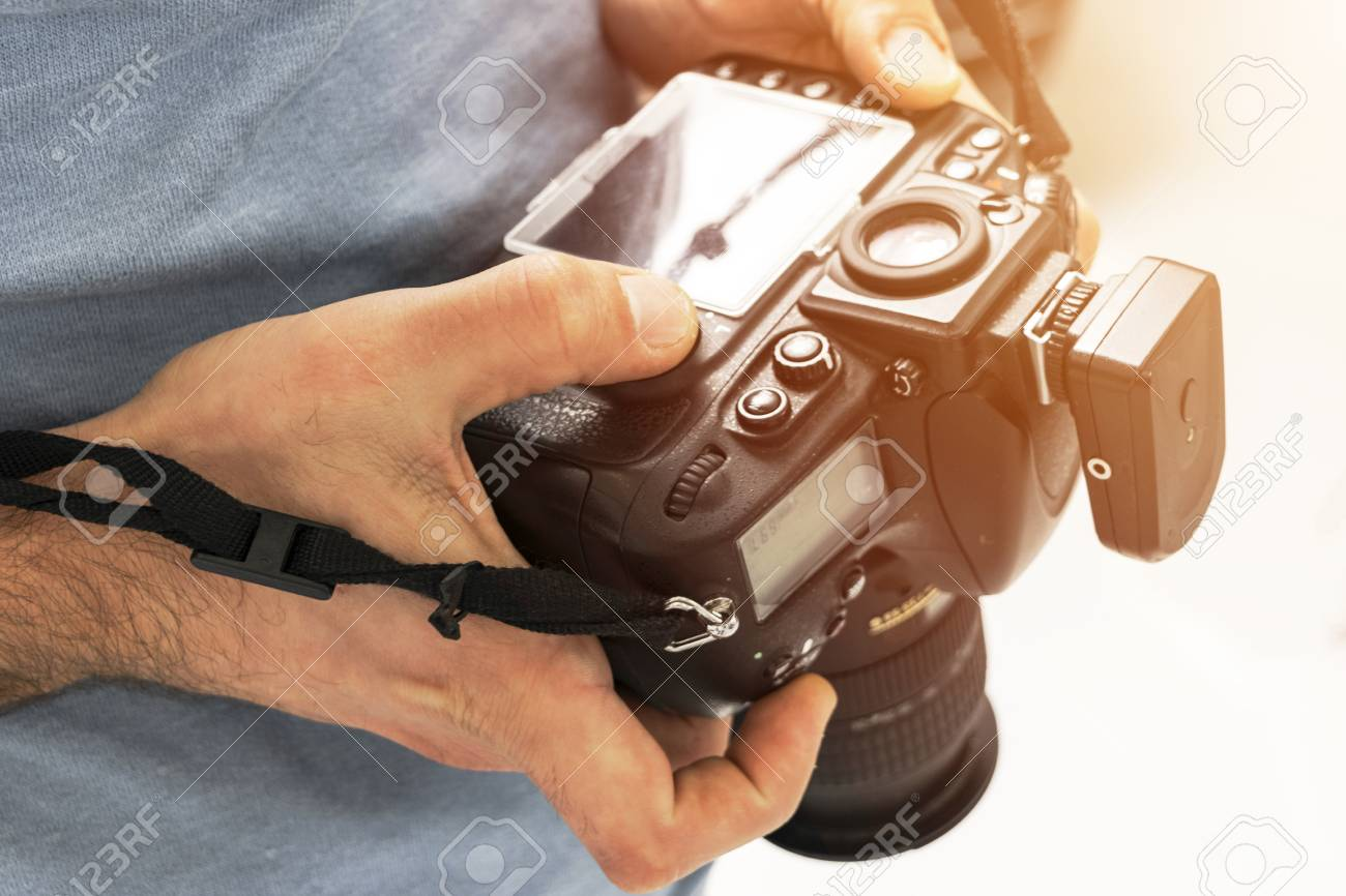Shooting Digital Photographs Through >> Digital Single Lens Reflex Camera In Male Hands Photographer