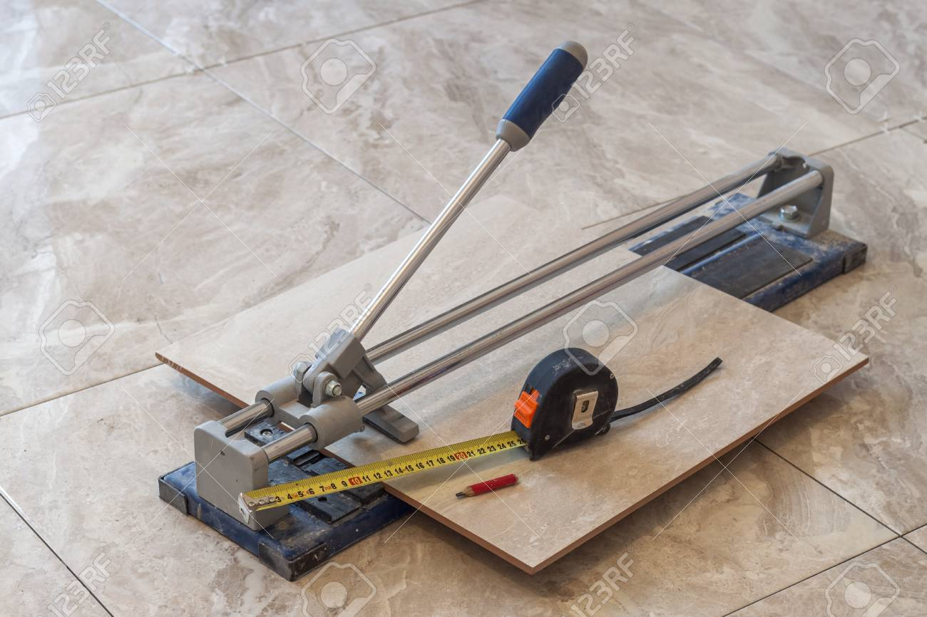 Ceramic tiles and tools for tiler floor tiles installation stock ceramic tiles and tools for tiler floor tiles installation home improvement renovation dailygadgetfo Images