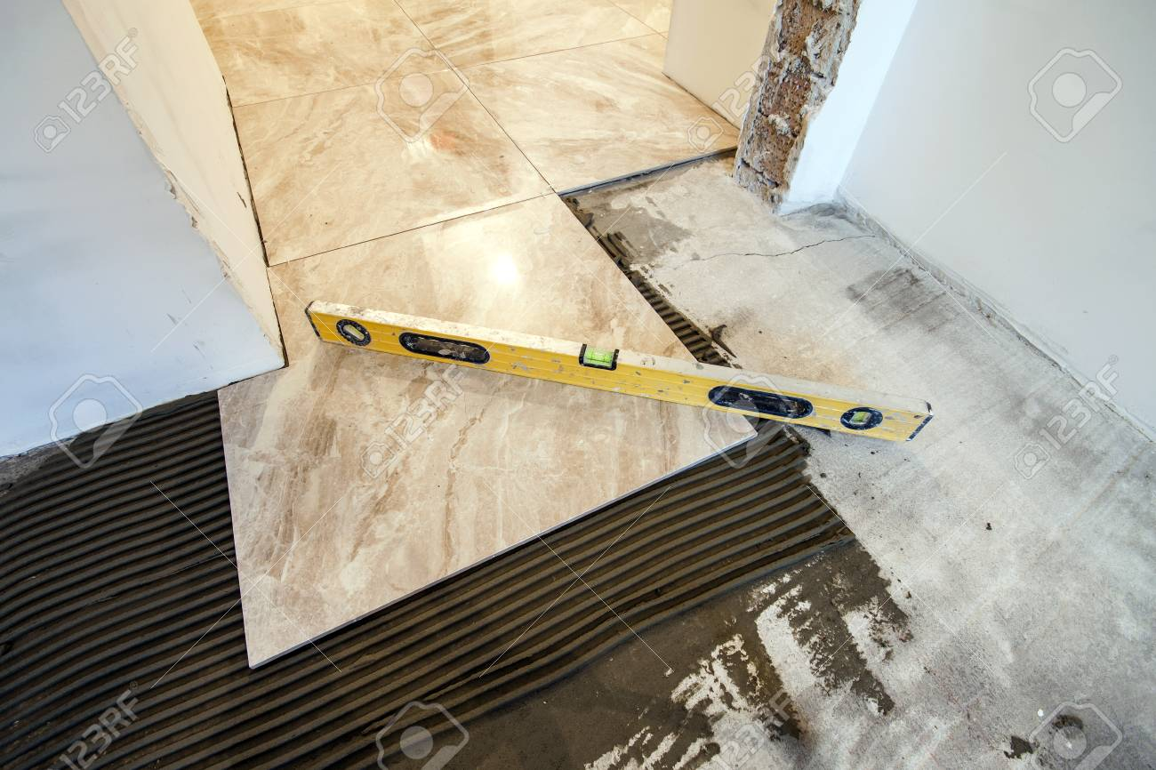 Ceramic tiles and tools for tiler floor tiles installation stock ceramic tiles and tools for tiler floor tiles installation home improvement renovation dailygadgetfo Image collections
