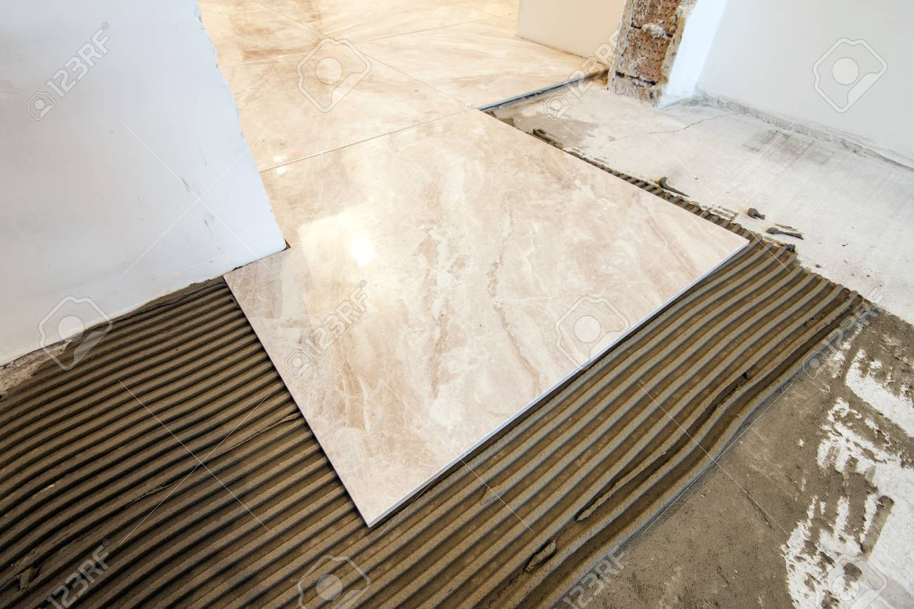 Ceramic tiles and tools for tiler floor tiles installation ceramic tiles and tools for tiler floor tiles installation home improvement renovation dailygadgetfo Images