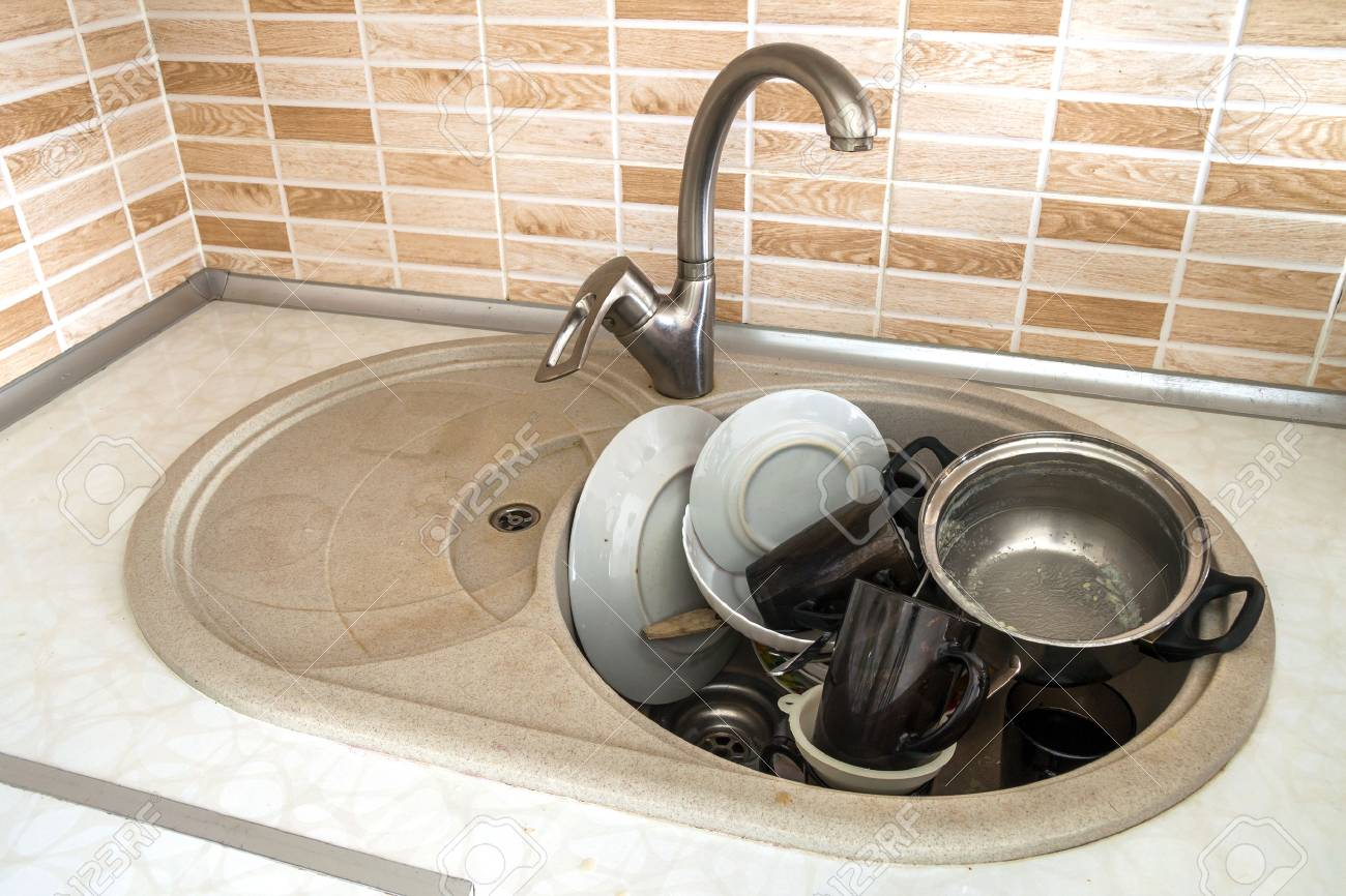 Heap Of Dirty Dishes In The Sink, In The Kitchen, From Above ... Unclean Kitchen Countertops on unhealthy kitchen, unkept kitchen, funny back in the kitchen, restaurant kitchen, wet kitchen, ugly kitchen, used kitchen, artisan kitchen, unsanitary kitchen,