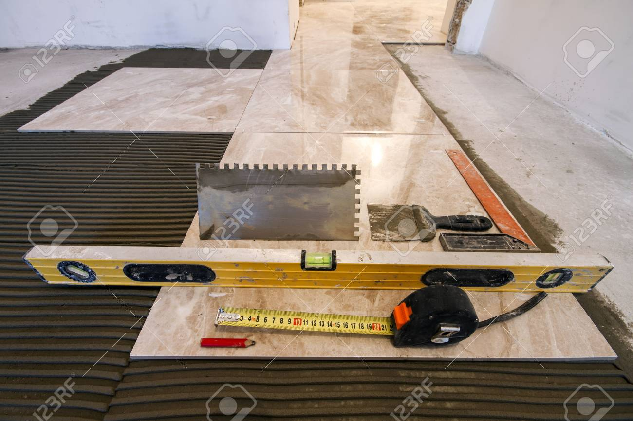 Ceramic tiles and tools for tiler floor tiles installation stock ceramic tiles and tools for tiler floor tiles installation home improvement renovation dailygadgetfo Choice Image