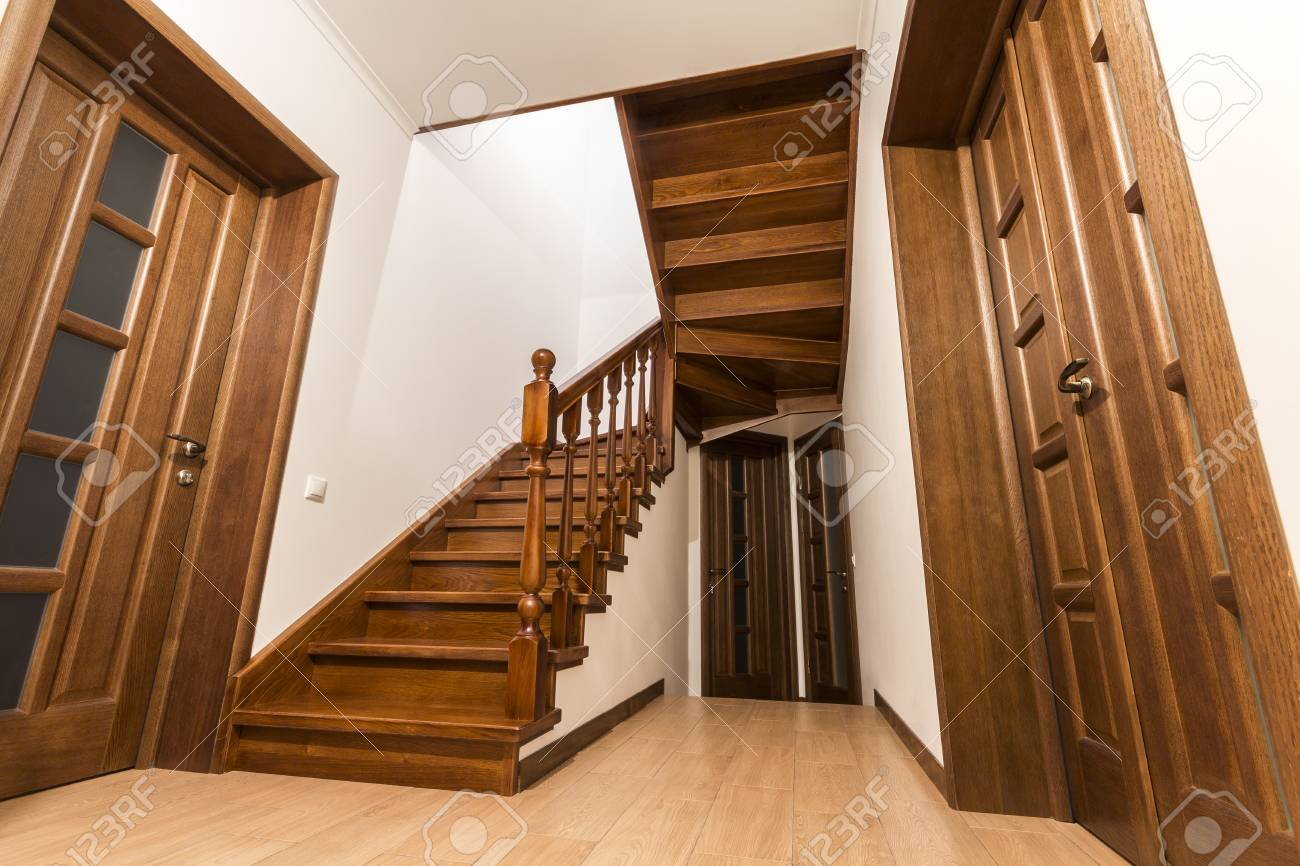 Modern Brown Oak Wooden Stairs And Doors In New Renovated House Interior  Stock Photo   97813257