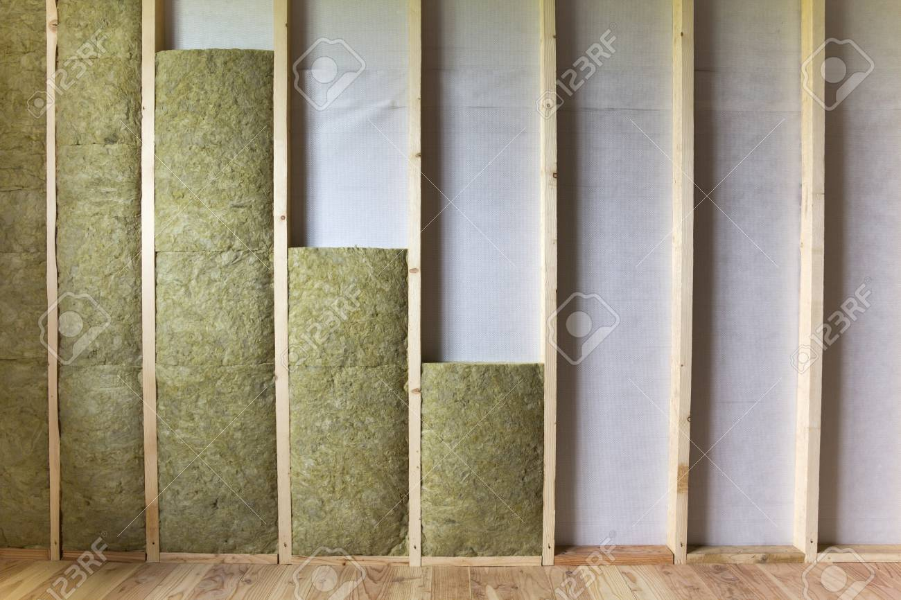 Wooden frame for future walls insulated with rock wool and fiberglass