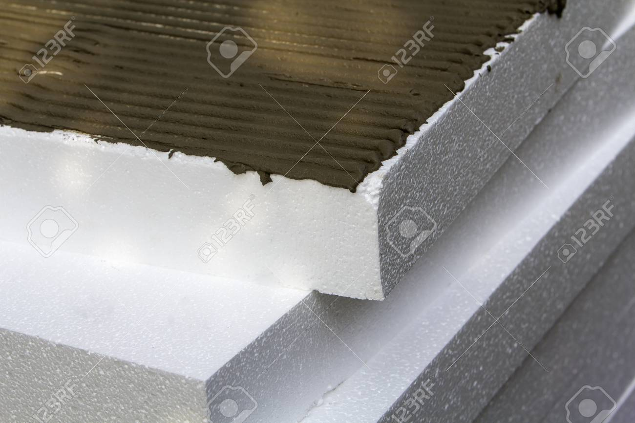 Close-up detail of stack of white rigid polyurethane foam sheets