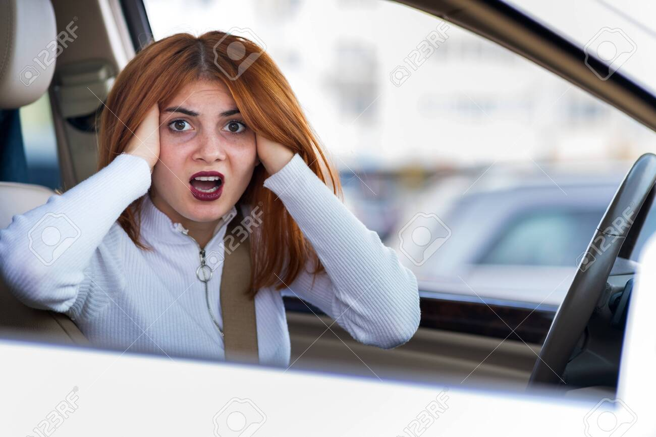 Closeup portrait of pissed off displeased angry aggressive woman driving a car shouting at someone. Negative human expression consept. - 136746830