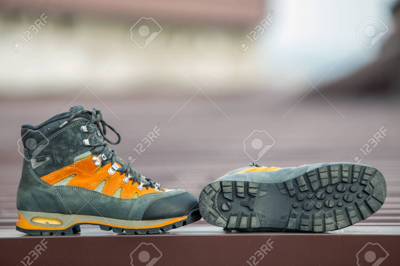 A pair of leather trekking hiking winter boots on blurred background - 137312767