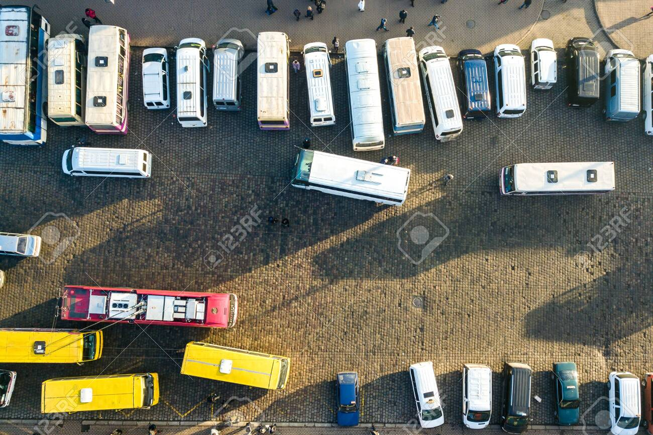 Aerial view of many cars and buses moving on a busy city street. - 141759242