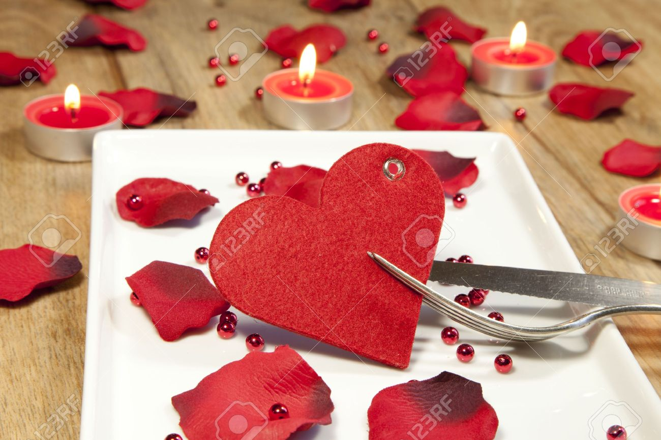 place setting for valentines day with petals Stock Photo - 12207644