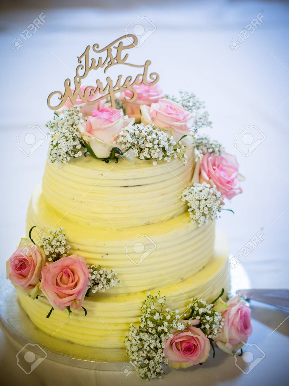 Wedding Cake With Pink Roses And Cream Stock Photo, Picture And ...