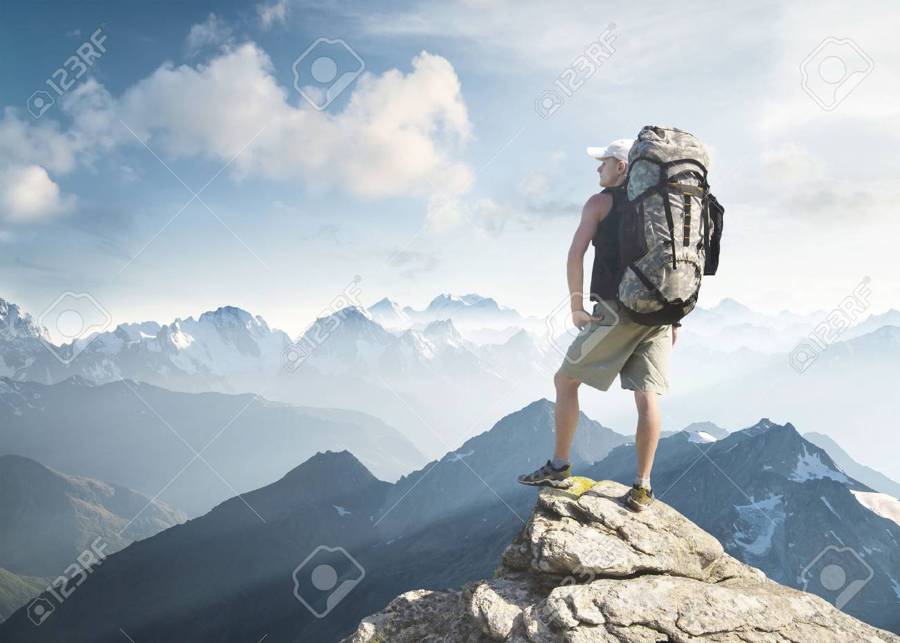 Tourist on the peak of high rocks. Sport and active life concept - 50750905
