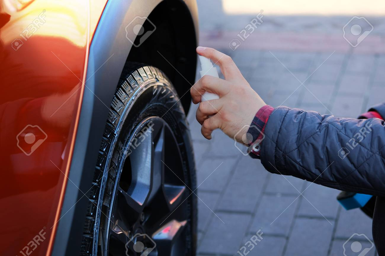 Spray Car Wash >> Man After Washing Applies Tire Cleaner With A White Spray Orange