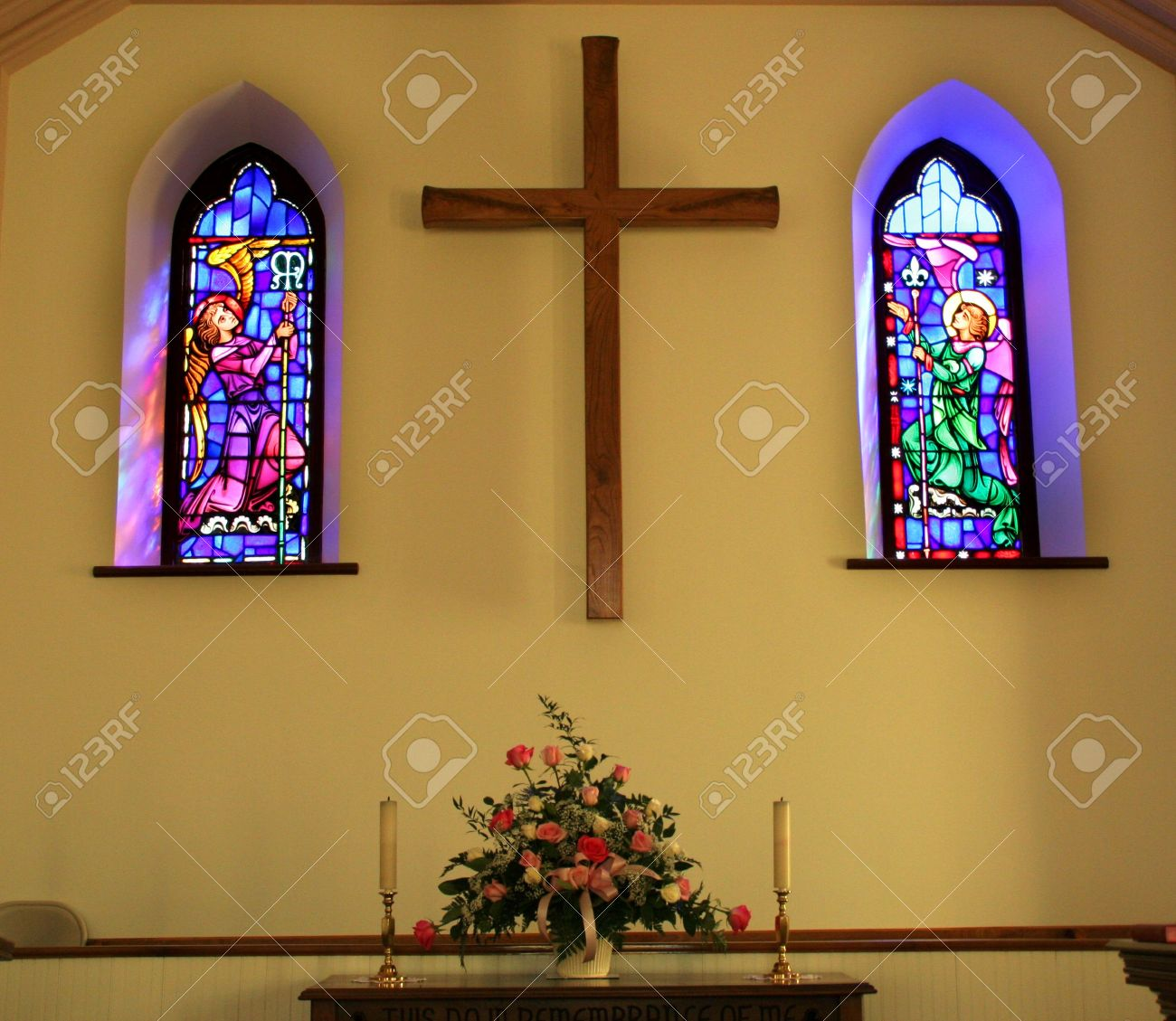 Church Interior With Stained Glass Windows Cross And Altar Stock Photo