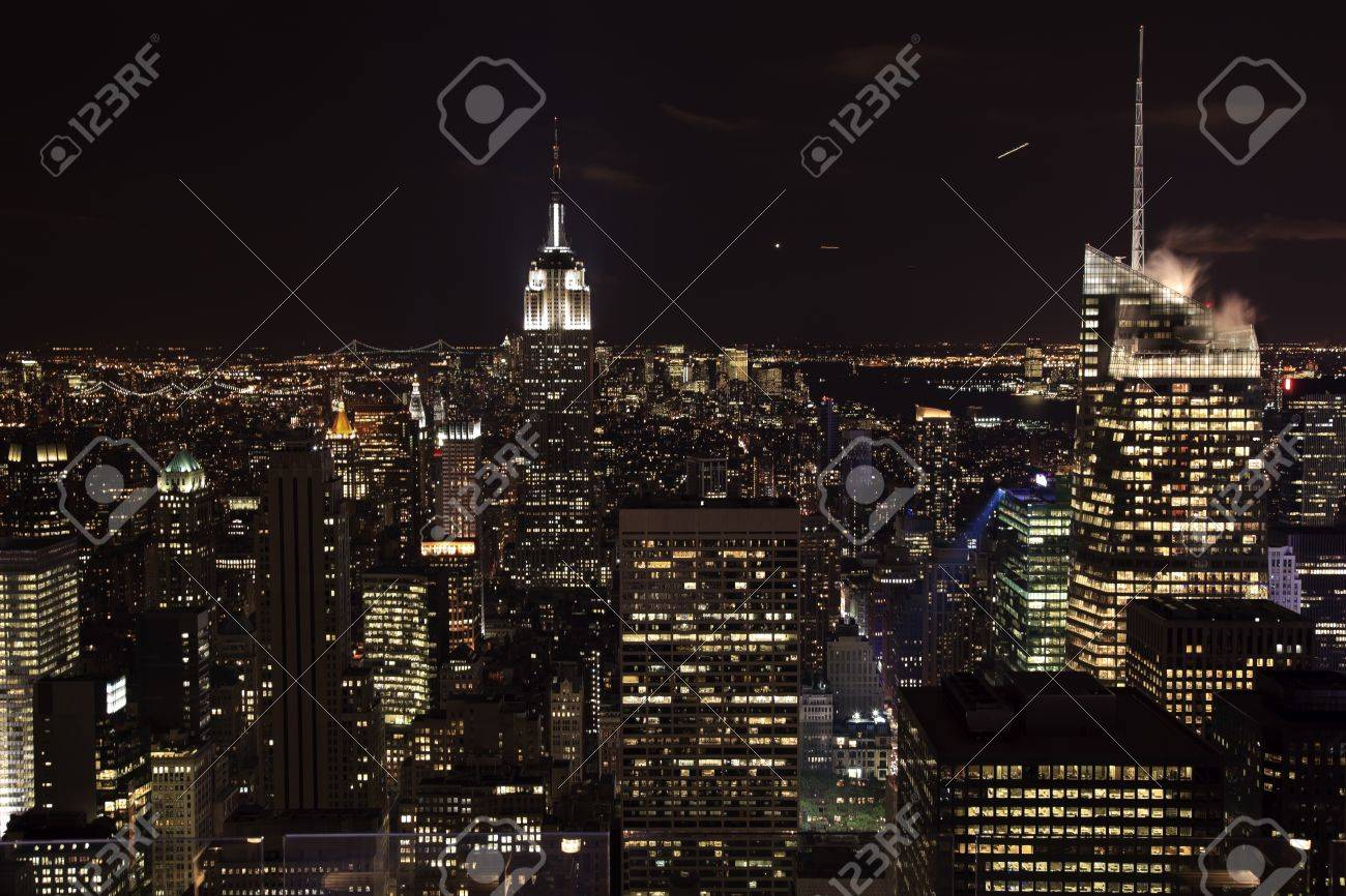 New York City Skyline East River Empire State Building Night Moon Airplanes Stock Photo - 8888753