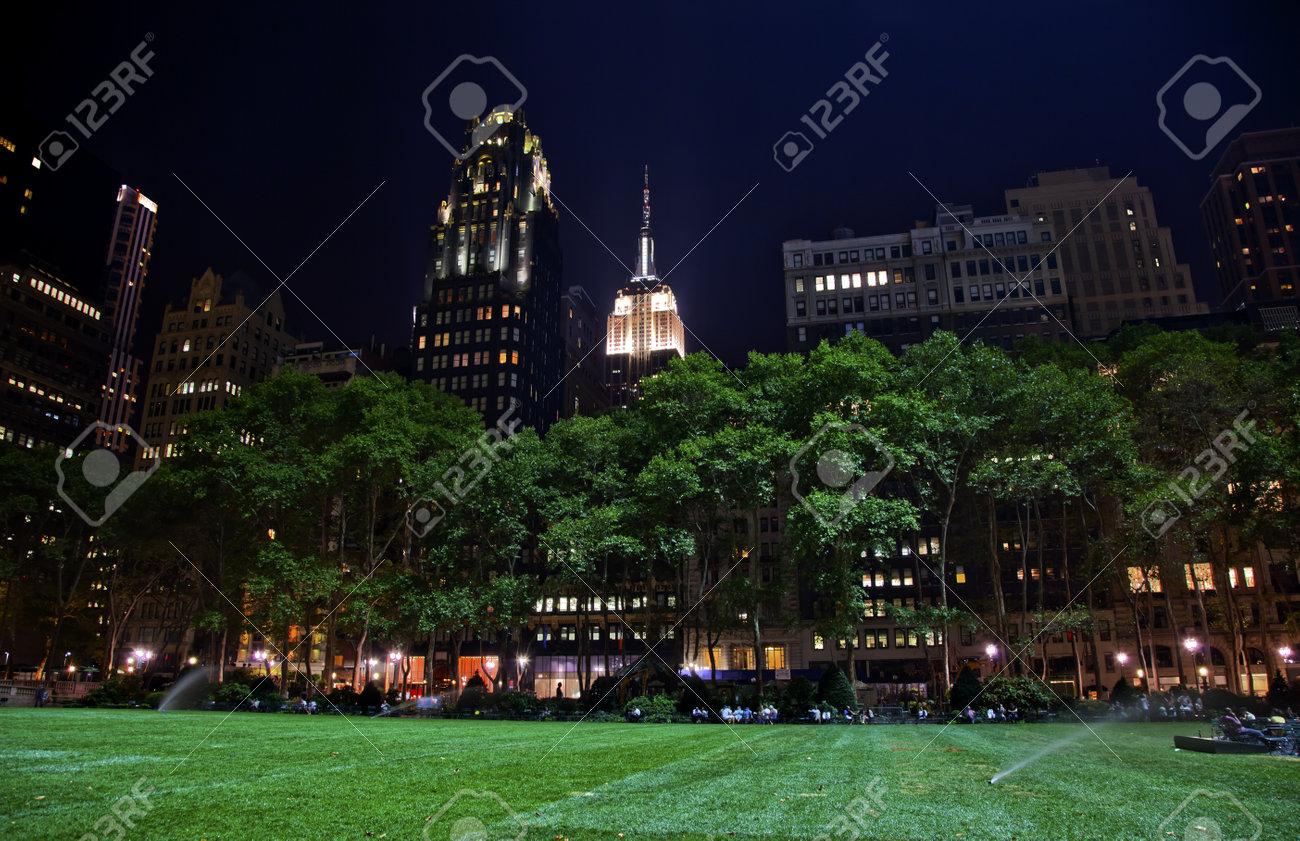 Bryant Park New York City Green Grass Skyline Apartment Buildings