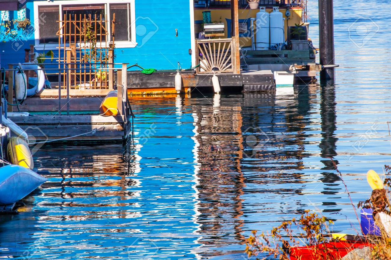 Floating Home Village Blue Houseboats Reflection Inner Harbor, Victoria Vancouver British Columbia Canada Pacific Northwest. Close to the center of Victoria, this area has floating homes, boats, piers, and restaurants Stock Photo - 23023316