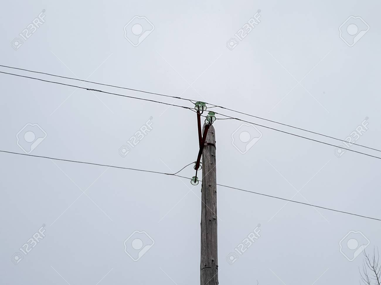 pole with electrical wires. Wooden pole holding live wires Live Wiring on