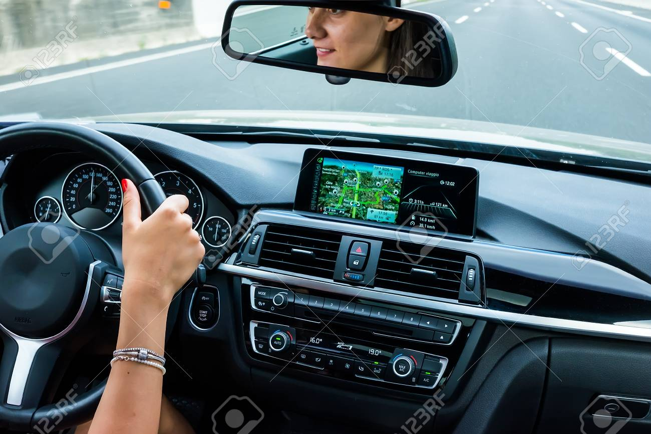 Beautiful Girl Driving A Luxury Black Car In The Interior View Stock