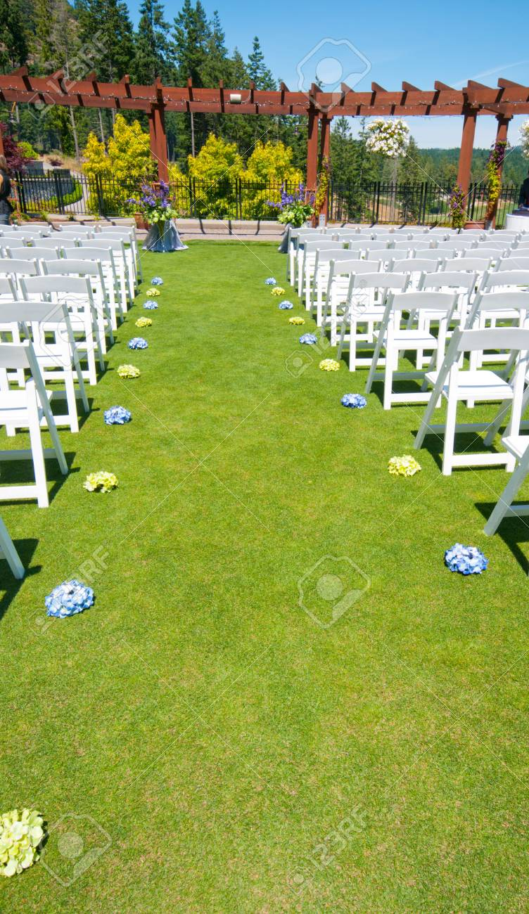 Outdoor Wedding Down The Isle White Chairs Victoria Canada Stock Photo Picture And Royalty Free Image Image 97665077