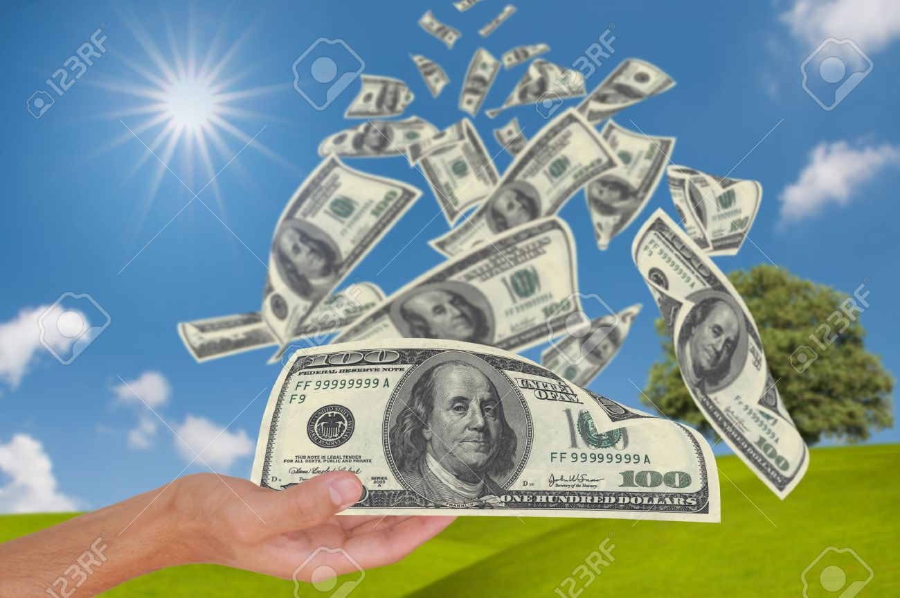 Hand get money falling from sky - 10785274