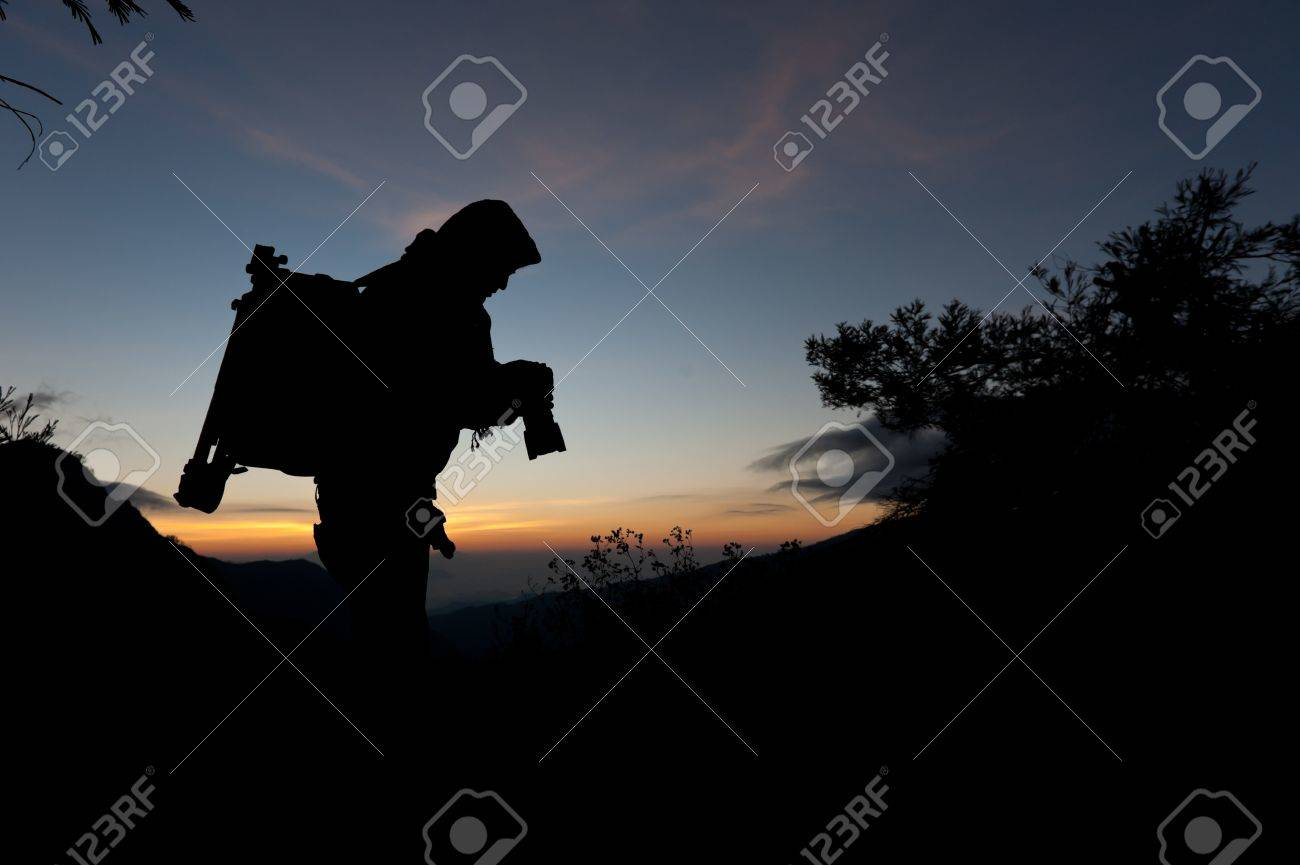 Silhouette of a cameraman against a sunrise Stock Photo - 11044183