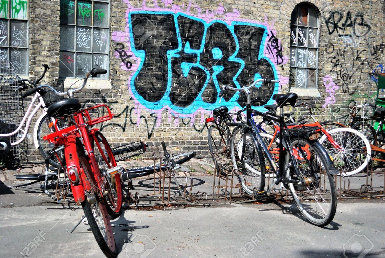 Two bikes and urban graffiti in Copenhagen, Christiania Stock Photo - 13761077